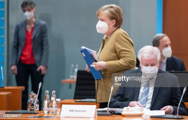 German Chancellor Angela Merkel and Federal Minister of the Interior, Building and Community Horst Seehofer arrive for the weekly government cabinet...