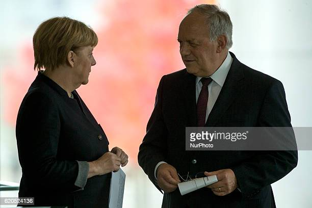German Chancellor Angela Merkel and Federal Swiss President Johann SchneiderAmmann chat prior to a news conference at the Chancellery in Berlin...