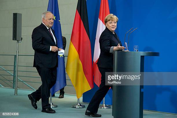 German Chancellor Angela Merkel and Federal Swiss President Johann SchneiderAmmann are pictured as they arrive to a news conference at the...
