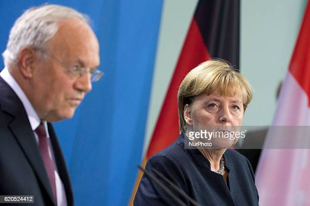 German Chancellor Angela Merkel and Federal Swiss President Johann SchneiderAmmann are pictured during a news conference at the Chancellery in Berlin...