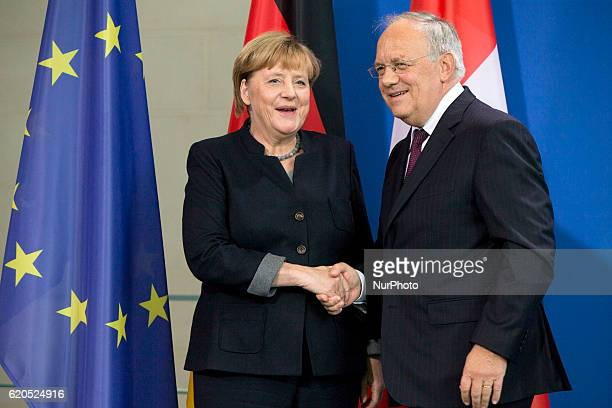 German Chancellor Angela Merkel and Federal Swiss President Johann SchneiderAmmann shake hands at the end of a news conference at the Chancellery in...