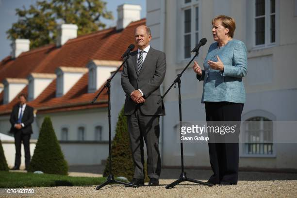 German Chancellor Angela Merkel and Finance Minister and Vice Chancellor Olaf Scholz speak to the media prior to talks between the German government...