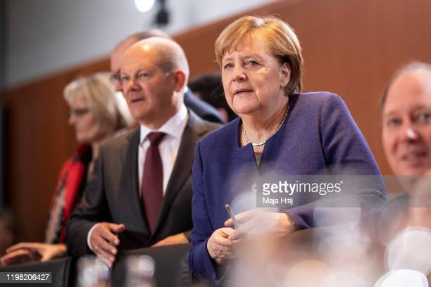 German Chancellor Angela Merkel and Finance Minister and Vice Chancellor Olaf Scholzarrive to a first government cabinet meeting of 2020 in the...