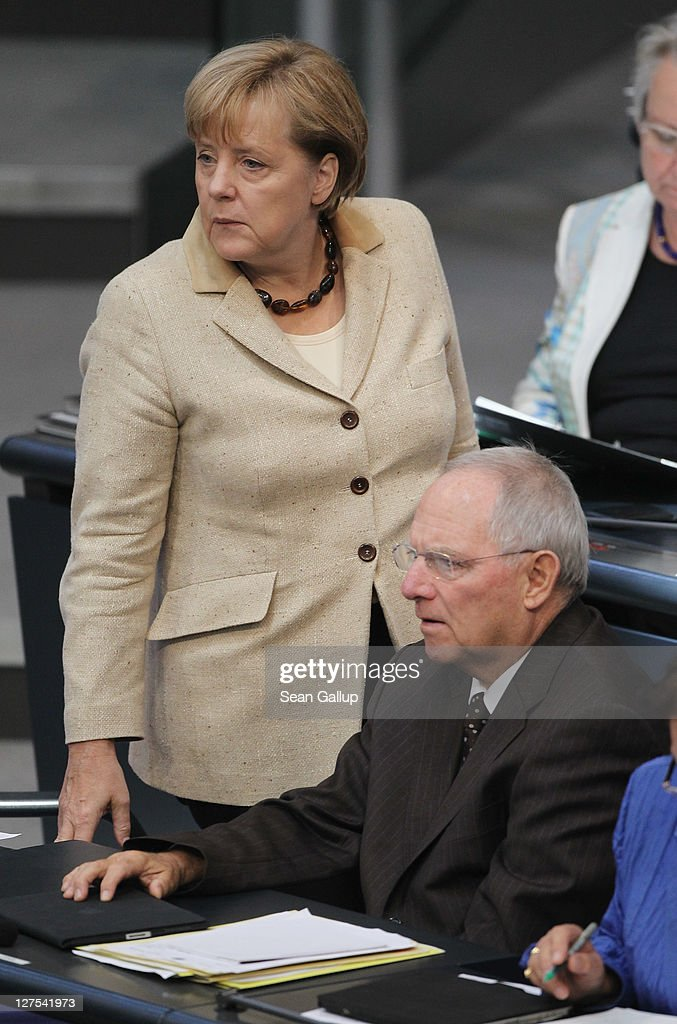 German Chancellor Angela Merkel and Finance Minister Wolfgang Schaeuble attend a session of the Bundestag in which members will vote on an increase in funding for the European Financial Stability Facility (EFSF) on September 29, 2011 in Berlin, Germany. Many analysts see the increase as crucial for safeguarding the future stability of the Euro in the face of the current debt crisis in Greece. Merkel is pressing for the increase, and though opposition parties have pledged to support the bill, up to 19 dissenters within the ranks of her own coalition might vote against it.