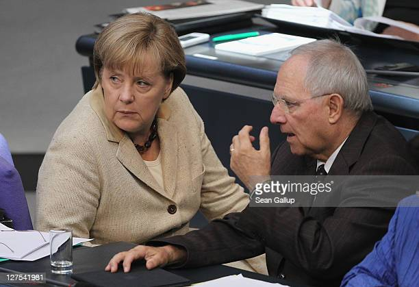 German Chancellor Angela Merkel and Finance Minister Wolfgang Schaeuble attend a session of the Bundestag in which members will vote on an increase...