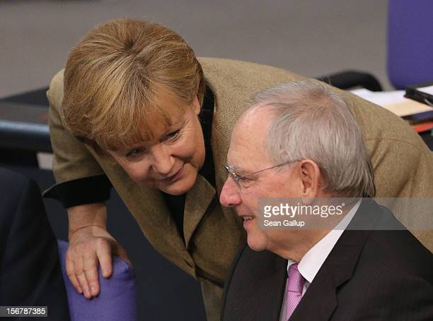 German Chancellor Angela Merkel and Finance Minister Wolfgang Schaeuble attend debates at the Bundestag over the 2013 federal budget on November 21...