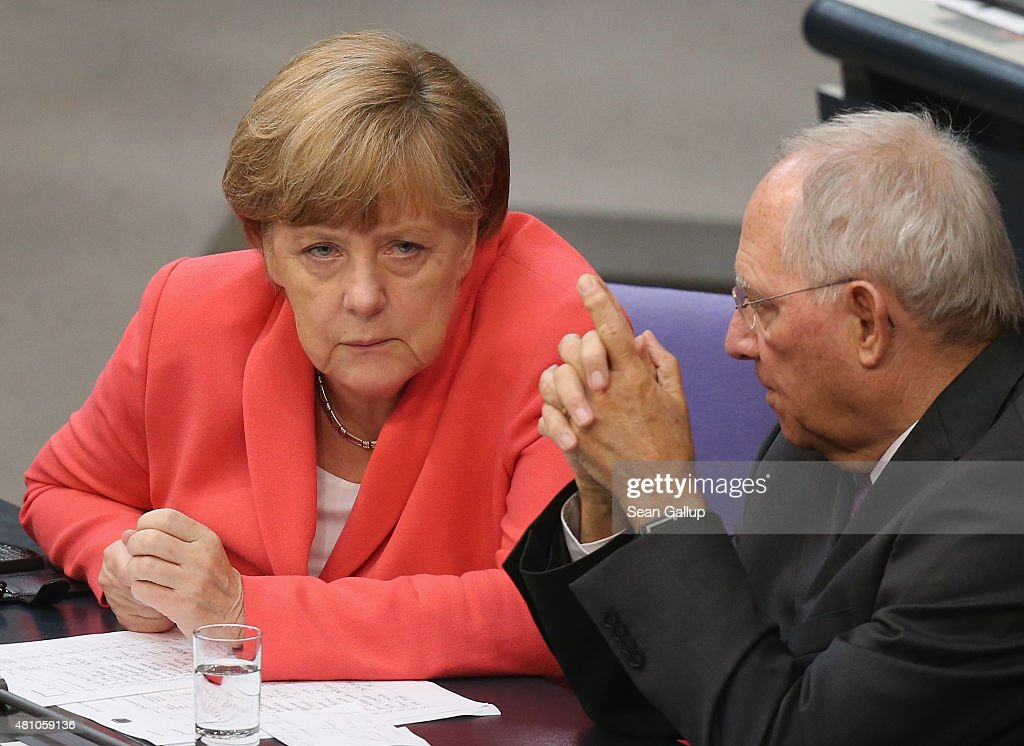 German Chancellor Angela Merkel and Finance Minister Wolfgang Schaeuble speak with one another during debates prior to votes over the third EU financial aid package to Greece at an extraordinary session of the German parliament, the Bundestag, on July 17, 2015 in Berlin, Germany. The Bundestag is among several European parliaments that must vote on whether to allow negotations over the aid package that will help Greece to avert state bankruptcy and shore up the Greek banking system.