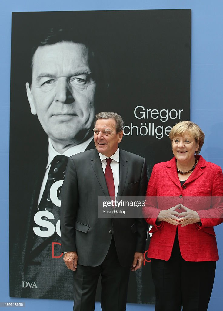 German Chancellor Angela Merkel and former Chancellor Gerhard Schroeder arrive for the presentation of Schroeder's biography on September 22, 2015 in Berlin, Germany. The biography, called 'Gerhard Schroeder - The Biography', is published by Deutsche Verlags-Anstalt and details Schroeder's rise from very modest origins to Germany's top political office.