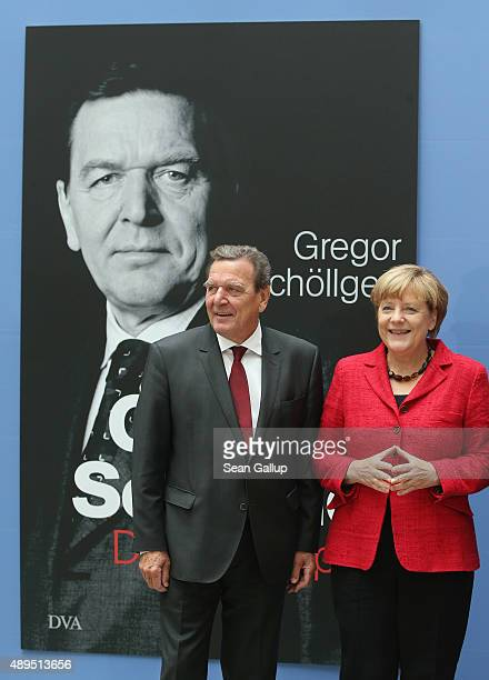 German Chancellor Angela Merkel and former Chancellor Gerhard Schroeder arrive for the presentation of Schroeder's biography on September 22 2015 in...