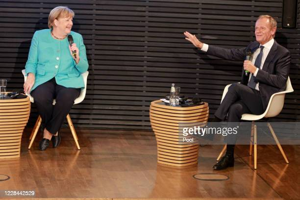 German Chancellor Angela Merkel and former EU Council President Donald Tusk take part in a conversation on the 30th anniversary of the German...
