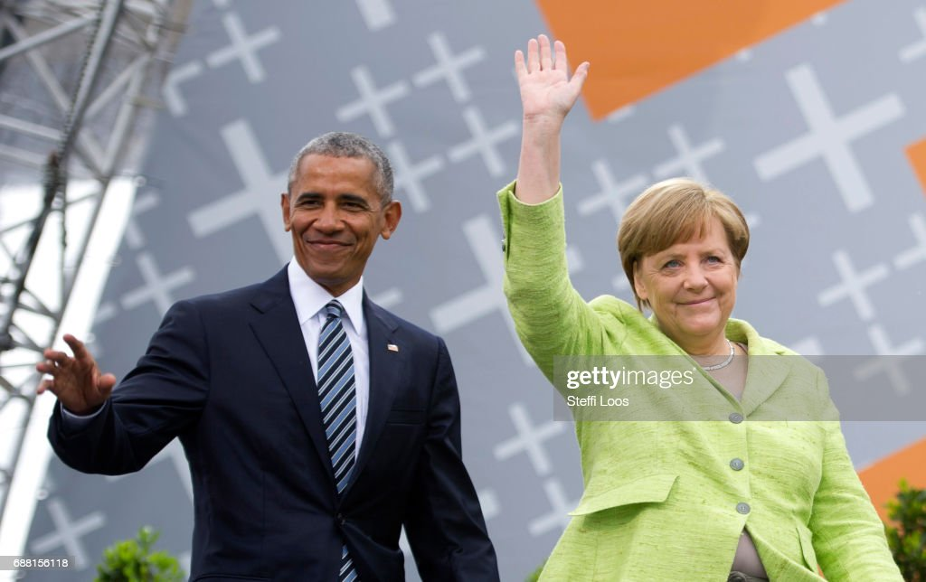 German Chancellor Angela Merkel and former President of the United States of America Barack Obama arrive for a discussion on democracy at Church Congress on May 25, 2017 in Berlin, Germany. Up to 200,000 faithful are expected to attend the five-day congress in Berlin and Wittenberg which is celebrating the 500th anniversary of the Reformation.