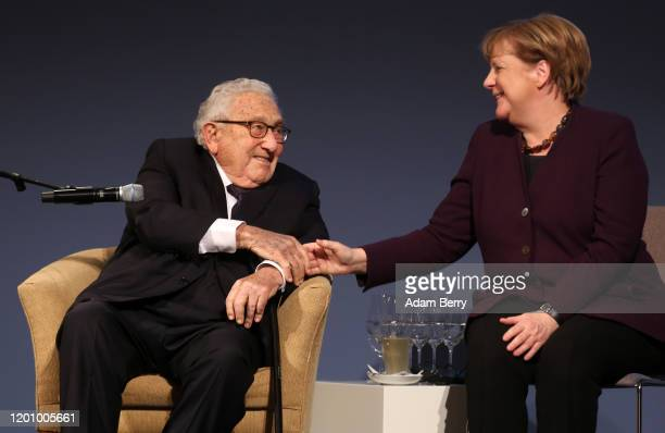 German Chancellor Angela Merkel and former United States Secretary of State and National Security Advisor Henry Kissinger attend the ceremony for the...