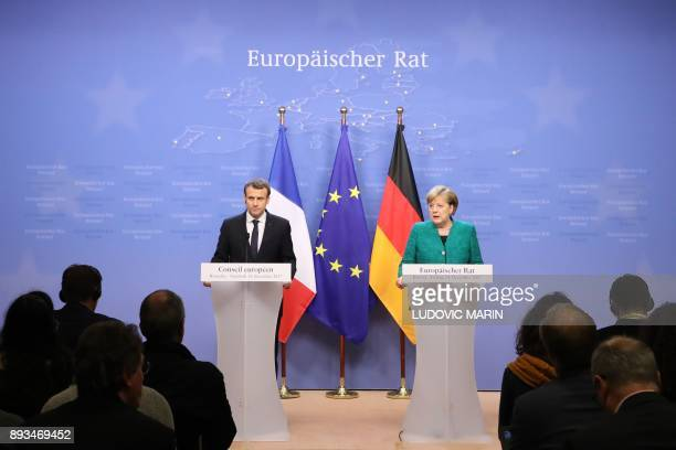 German Chancellor Angela Merkel and France's President Emmanuel Macron give a joint press conference at the end of a European Union summit in...