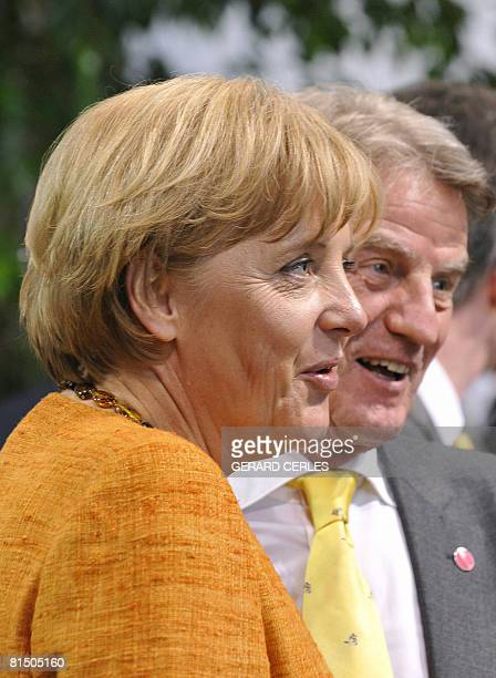 German Chancellor Angela Merkel and French Foreign minister Bernard Kouchner joke ahead of the French-German one-day summit on June 9, 2008 in the...