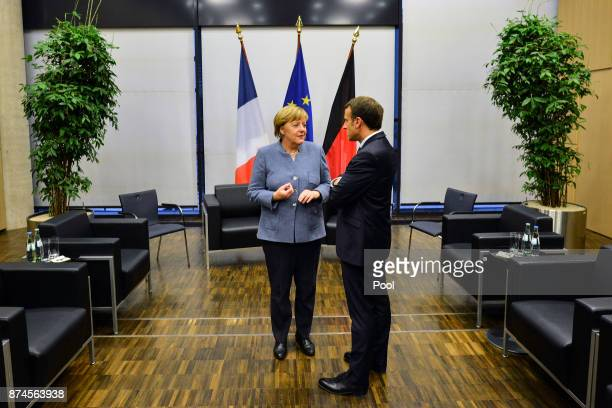 German Chancellor Angela Merkel and French president Emanuel Macron hold a bilateral talk during the UN Climate Change Conference COP23 on November...