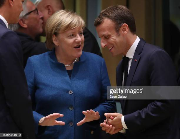German Chancellor Angela Merkel and French President Emmanuel Macron chat prior to a meeting of EU leaders to discuss Brexit at the European Council...