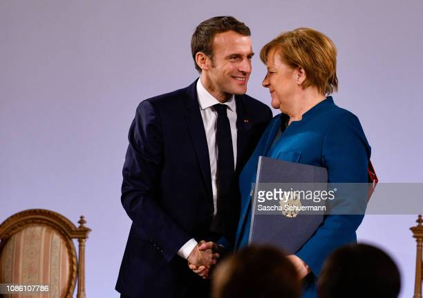 German Chancellor Angela Merkel and French President Emmanuel Macron sign the Aachen Treaty on January 22 2019 in Aachen Germany The treaty is meant...
