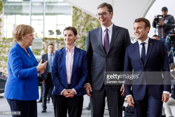 German Chancellor Angela Merkel and French President Emmanuel Macron greet Serbian President Aleksandar Vucic and Serbian Prime Minister Ana Brnabic...