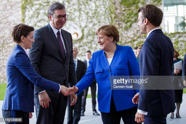 German Chancellor Angela Merkel and French President Emmanuel Macron greet Serbian President Aleksandar Vucic and Serbian Prime Minister Ana Brnabic...