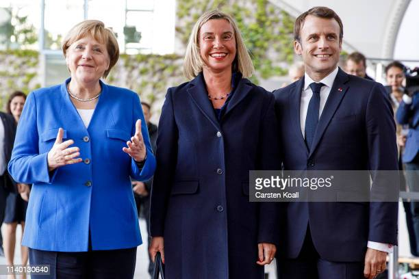 German Chancellor Angela Merkel and French President Emmanuel Macron greet EU High Representative of the Union for Foreign Affairs and Security...