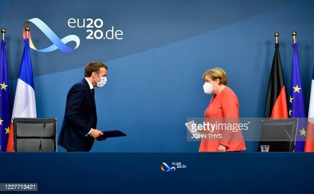 German Chancellor Angela Merkel and French President Emmanuel Macron leave after their joint video press conference at the end of the European summit...