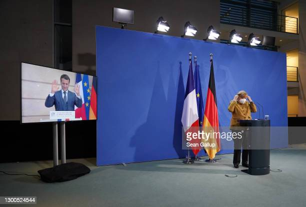 German Chancellor Angela Merkel and French President Emmanuel Macron, who is tuning in from Paris via video link, depart after speaking to the media...