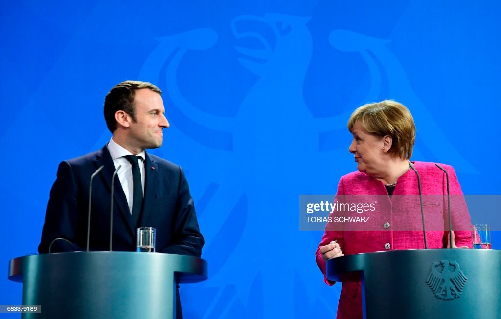 French President Emmanuel Macron Meets Angela Merkel In Berlin