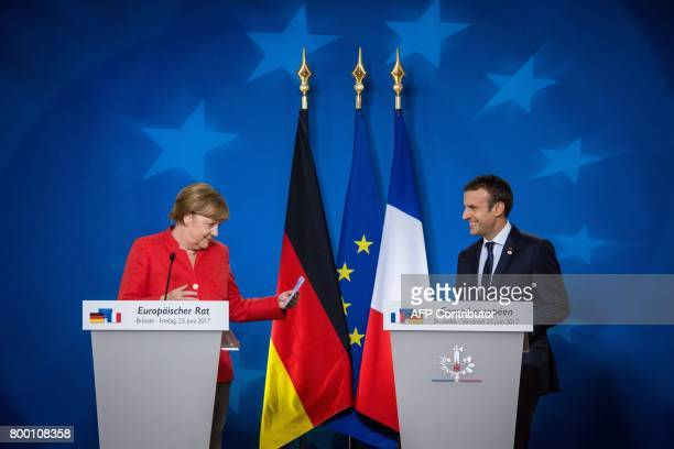 German Chancellor Angela Merkel and French President Emmanuel Macron give a joint press conference following the European Union leaders summit at the...