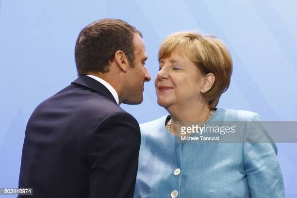German Chancellor Angela Merkel and French President Emmanuel Macron shake hands after a Press conference after a meeting of European Union leaders...