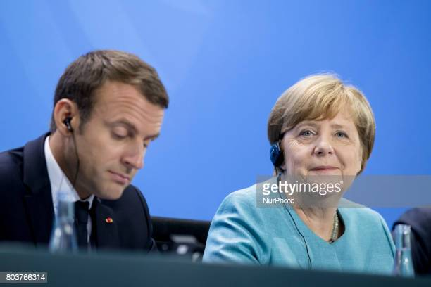 German Chancellor Angela Merkel and French President Emmanuel Macron are pictured during a news conference at the Chancellery in Berlin Germany on...