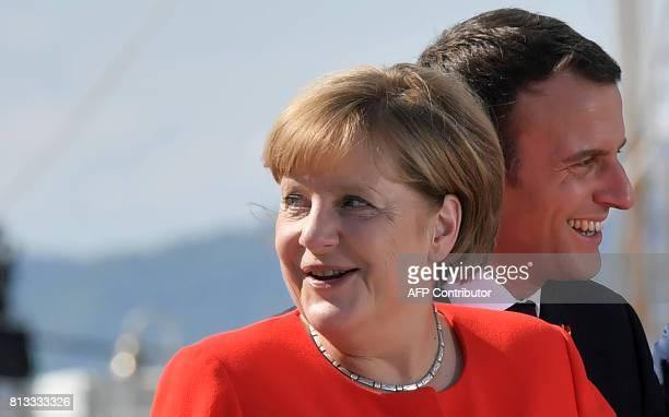 German Chancellor Angela Merkel and French President Emmanuel Macron attend the Western Balkans summit in Piazza Unita d'Italia in Trieste northern...