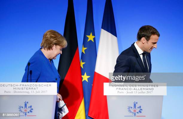 German Chancellor Angela Merkel and French President Emmanuel Macron leave after their joint press conference at the Elysee Presidential Palace on...