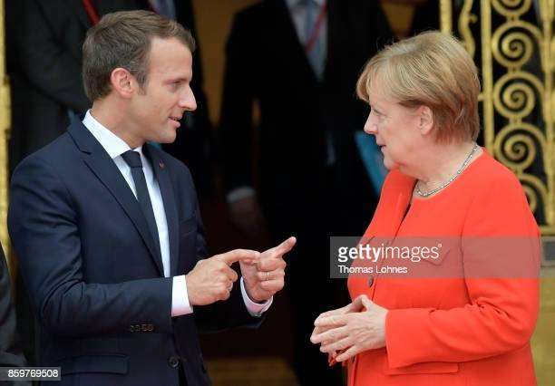 German Chancellor Angela Merkel and French President Emmanuel Macron pictured before bilateral talks while attending the opening of the Frankfurt...