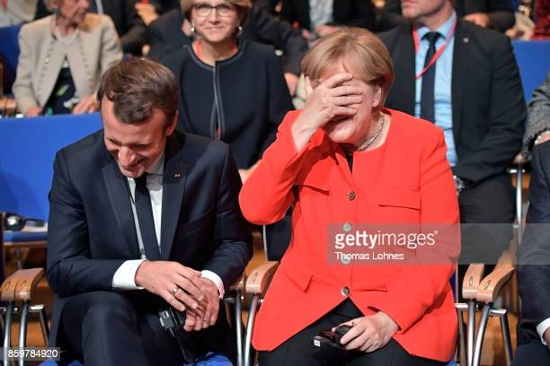 German Chancellor Angela Merkel and French President Emmanuel Macron pictured before the opening of the Frankfurt Book Fair 2017 on October 10 2017...