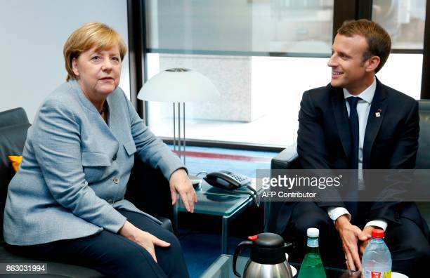 German Chancellor Angela Merkel and French President Emmanuel Macron attend a bilateral meeting in Brussels on October 19 2017 on the first day of a...