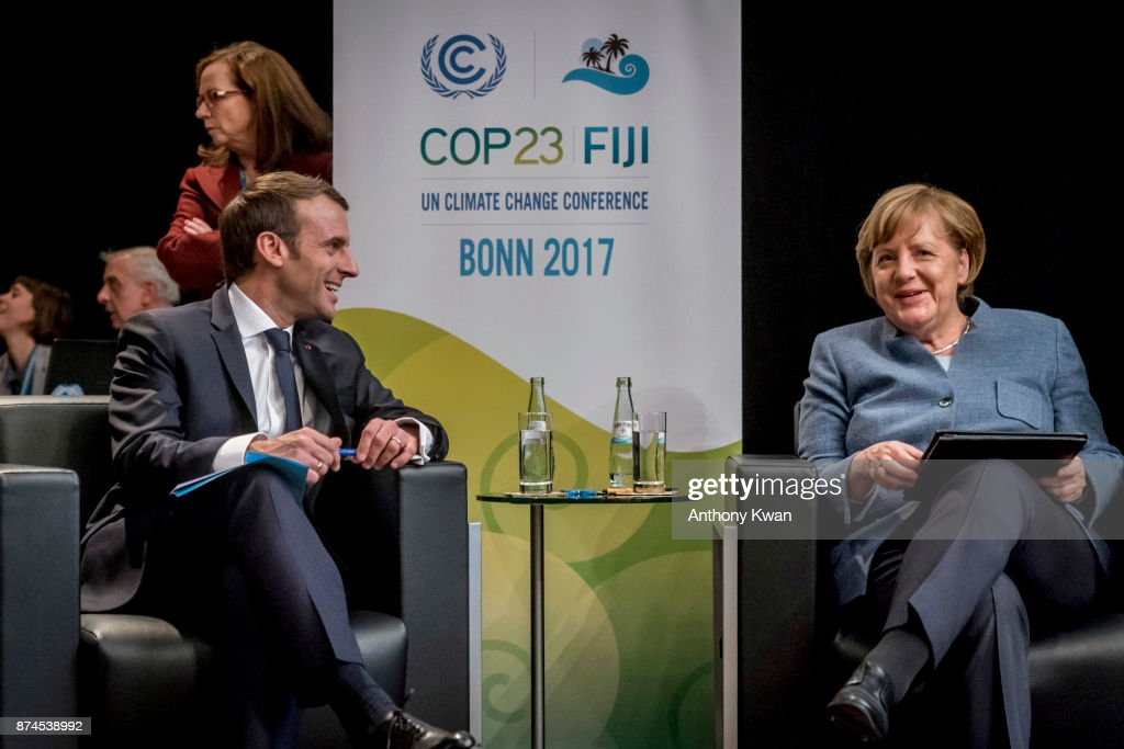 German Chancellor Angela Merkel and French President Emmanuel Macron attend the COP 23 United Nations Climate Change Conference on November 15, 2017 in Bonn, Germany. The conference, which ends on November 17, has brought together 25,000 participants to discuss climate change-related issues and the progress signatory members are making towards fulfilling CO2 and other pollutants reductions. Many signatories of the Paris Agreement are failing to fulfill their commitments towards combating the global temperature rise. Recent data shows that global CO2 levels are again rising after having stagnated the last couple of years.