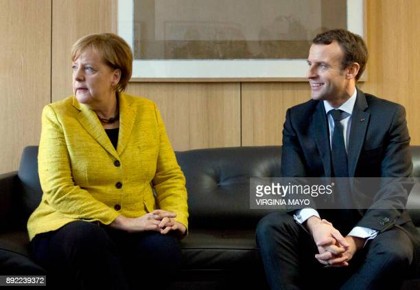 German Chancellor Angela Merkel and French President Emmanuel Macron speak during a meeting on the sidelines of an EU summit at The Europa building...