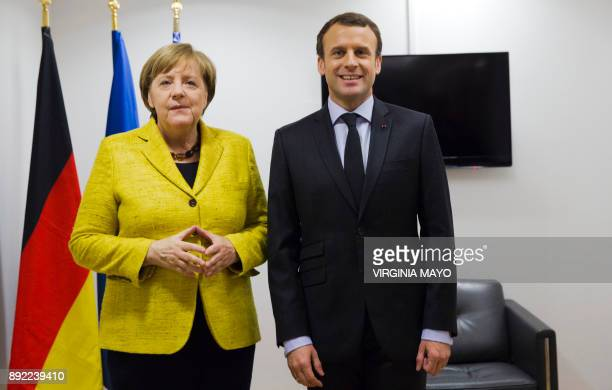 German Chancellor Angela Merkel and French President Emmanuel Macron pose for photographers prior to a meeting on the sidelines of an EU summit at...