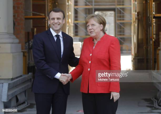German Chancellor Angela Merkel and French President Emmanuel Macron arrive to visit the Humboldt Forum construction site on April 19 2018 in Berlin...