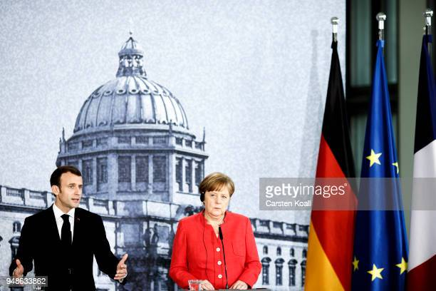 German Chancellor Angela Merkel and French President Emmanuel Macron attend a pressconference following a visit in the Humboldt Forum construction...