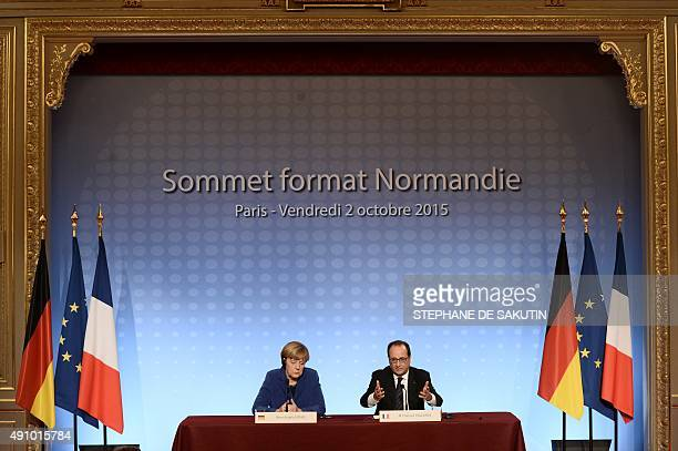 German Chancellor Angela Merkel and French President Francois Hollande address a joint press conference following a peace summit on Ukraine at the...
