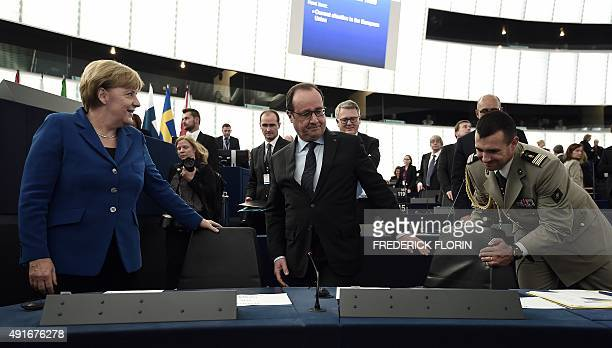 German Chancellor Angela Merkel and French President Francois Hollande arrive prior to their joint address at the European Parliament on October 7...
