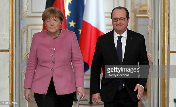 German Chancellor Angela Merkel and French President Francois Hollande arrive to attend a press conference at the Elysee Presidential Palace on March...