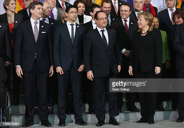 German Chancellor Angela Merkel and French President Francois Hollande as well as French Minister of Industrial Renewal and German Economy Minister...