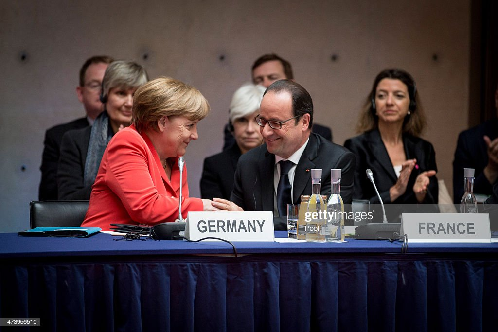 German Chancellor Angela Merkel and French President Francois Hollande attend the 6th Petersburger Climate Conference (Petersburger Klimadialog) at the Axica center on May 19, 2015 in Berlin, Germany. The May 18-19 conference brings together representatives from 35 nations to discuss climate-related issues ahead of the upcoming UN Climate Conference in Paris.