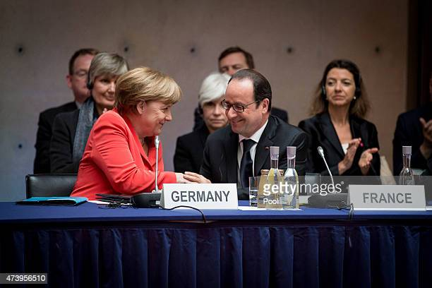 German Chancellor Angela Merkel and French President Francois Hollande attend the 6th Petersburger Climate Conference at the Axica center on May 19...