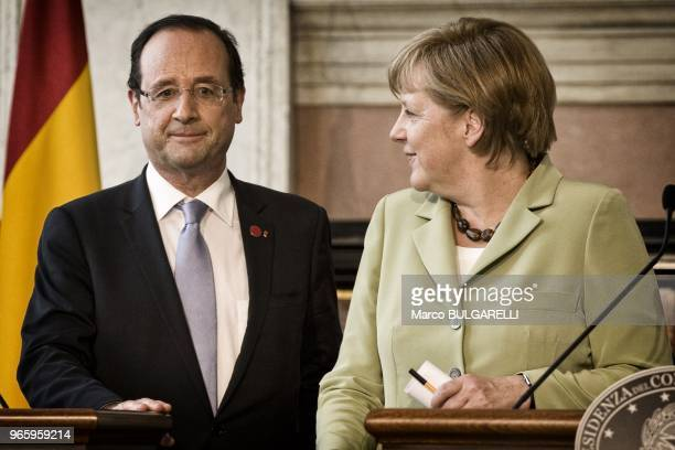 German Chancellor Angela Merkel and French President Francois Hollande during the press conference after the quadrilateral meeting at Villa Madama on...