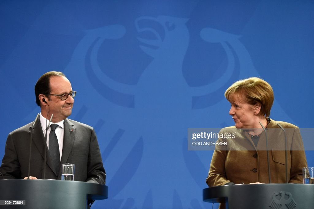 TOPSHOT - German Chancellor Angela Merkel and French President Francois Hollande give a joint press conference on December 13, 2016 at the Chancellery in Berlin. /