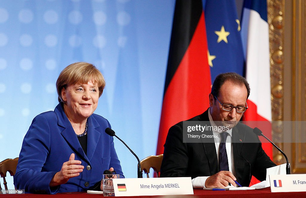 German Chancellor Angela Merkel (L) and French President Francois Hollande (R) hold a press conference following a summit on Ukraine on 02 October 2015, in Paris, France. German Chancellor Angela Merkel, Ukrainian President Petro Poroshenko, French President Francois Hollande and Russian President Vladimir Putin took part in the summit. The summit is planned as a follow-up meeting to a Minsk peace agreement inked in February to end ongoing conflict in the eastern part of Ukraine.