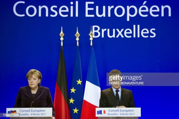 German Chancellor Angela Merkel and French President Nicolas Sarkozy give a joint press conference during the EU summit on February 4, 2011 at the...
